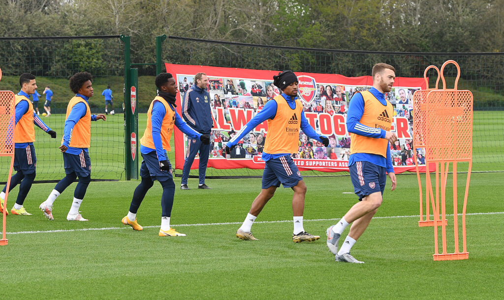 Players training in front of the banner