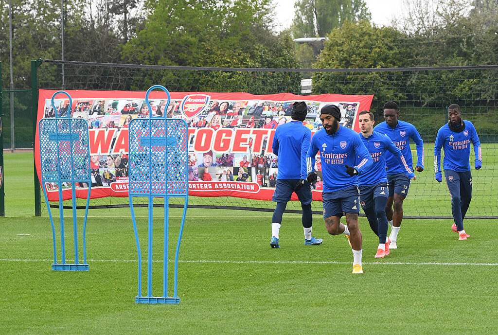 Some of the first team training in front of the banner